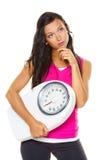 Le femme est dissatisfait avec le poids corporel photographie stock