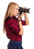 Le femme-photographe de charme prend des images - d'isolement sur le blanc Photo stock
