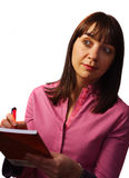 Le femme prend des notes et les observe Photographie stock