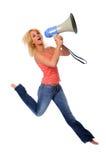 Le femme sautant avec le mégaphone Image stock