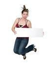 Le femme sautant avec le signe image stock