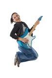 Le femme sautant avec une guitare photo stock