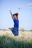 Le femme saute Photos stock