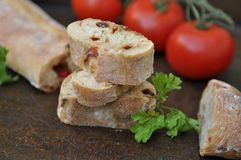 Le fette al forno del pane si chiudono su Fotografie Stock