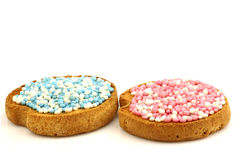 Le fette biscottate con bianco ed azzurro e colore rosa spruzza Fotografia Stock