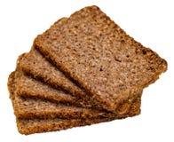 Le fette di multigrain del grano intero tostano sul backgro bianco immagini stock libere da diritti