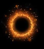 Le feu brûlant en rond avec des étincelles Photo stock