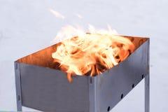 Le feu dans le gril Photos stock