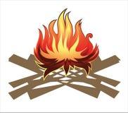 Le feu en bois de camp d'isolement sur le blanc Image stock