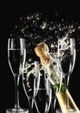 Le feu et champagne Images stock