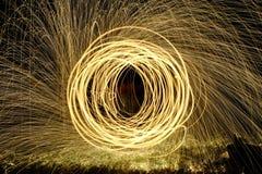 Le feu POI, rotation flamboyante de laine en acier Photos libres de droits
