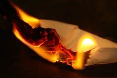 Le feu sur le papier Photos libres de droits