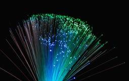 Le fibre ottiche accende il fondo astratto, fondo ottico della fibra Fotografia Stock