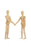 Le figure di legno stringono le mani Fotografie Stock Libere da Diritti