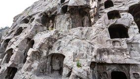 Le figure scolpite e frana il pendio della collina ad ovest Fotografia Stock