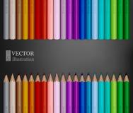 Le file dell'arcobaleno hanno colorato le matite su fondo grigio scuro royalty illustrazione gratis