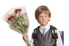 Le first-grader avec un bouquet Photo libre de droits
