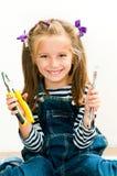 Le flicka med plattång och skiftnyckeln Royaltyfria Foton