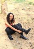 Le flickan i wetsuit Arkivfoto