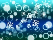 Le flocon de neige Bokeh signifie le Joyeux Noël et l'a brouillé Images stock