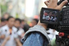 Le fonctionnaire de gouvernement donne une entrevue Photographie stock libre de droits