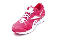 Le fonctionnement rouge folâtre des chaussures Image libre de droits