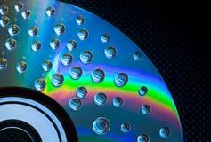 Le fond abstrait de musique, l'eau chute sur CD/DVD photographie stock