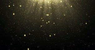 Le fond abstrait de particules de scintillement d'or avec les étoiles brillantes tombant vers le bas et la fusée légère ou l'écla image libre de droits