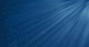 Le fond bleu de gradient abstrait avec le bokeh et les particules coulant avec la lumière de rayon, vacances de fête d'événements