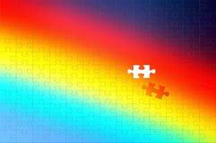 le fond d'arc-en-ciel d'un puzzle avec un rapièce photographie stock libre de droits
