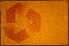 Le fond de carton avec réutilisent le symbole images stock