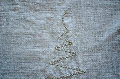 Le fond de chemise de toile brodent le plan rapproché d'ornement Image libre de droits