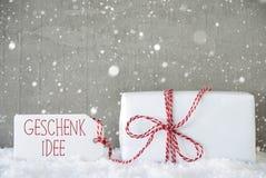 Le fond de ciment avec des flocons de neige, Geschenk Idee signifie l'idée de cadeau Images stock