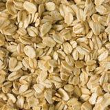 Le fond de farine d'avoine a roulé le plan rapproché cru d'instruction-macro d'avoine Images stock