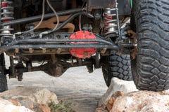 Le fond de la jeep se tenant sur la pierre Photographie stock