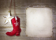 Le fond de Noël de cowboy avec les jouets occidentaux rejettent et se tiennent le premier rôle sur o Photo stock