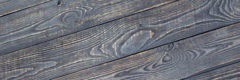 Le fond foncé de la texture en bois embarque avec des résidus de peinture diagonal images libres de droits