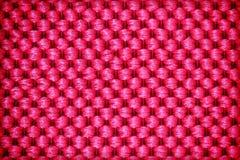 Le fond ou la texture rouge de textile de fibre Photos libres de droits