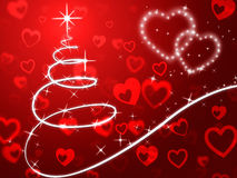 Le fond rouge d'arbre de Noël montre des vacances et l'amour Photographie stock