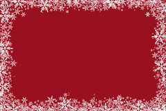 Le fond rouge de Noël tient le premier rôle des flocons de neige Photos libres de droits