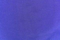 Le fond, texture d'un tissu pourpre de débardeur Photographie stock