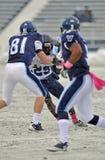 Le football 2011 de NCAA - bloqué dans la neige Photographie stock libre de droits