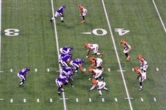 Le football 7 de NFL dans le cadre, 1 dos de fonctionnement Image libre de droits