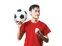 Le football asiatique de fan de foot de personnes thaïlandaises dans l'isolat rouge de chemise de douille photographie stock libre de droits