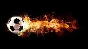 Le football avec les particules débordantes du feu photos stock