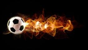 Le football avec les particules débordantes du feu photographie stock libre de droits