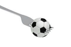 Le football comme nourriture : le football et fourchette Images libres de droits