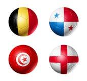 Le football de la Russie drapeaux de 2018 groupes G sur des ballons de football Photo libre de droits
