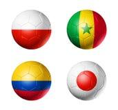 Le football de la Russie drapeaux de 2018 groupes H sur des ballons de football Photos libres de droits