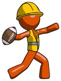 Le football de lancement de Contractor Man de travailleur de la construction orange Image stock
